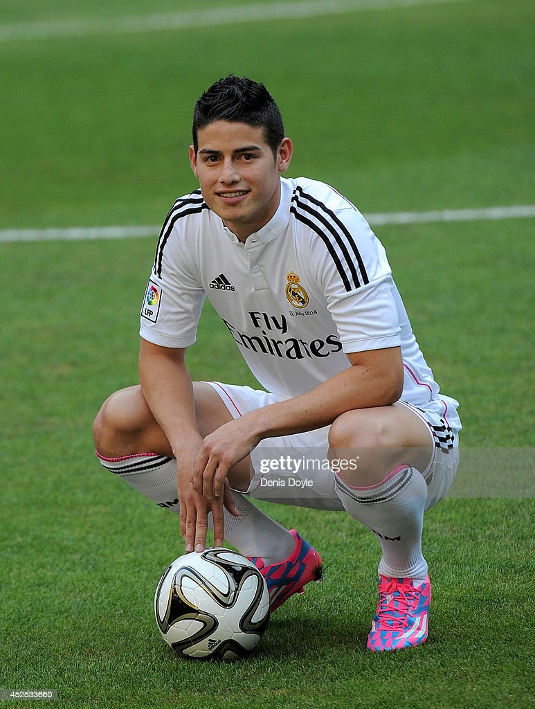 <a gi-track='captionPersonalityLinkClicked' href=/galleries/search?phrase=James+Rodriguez&family=editorial&specificpeople=4422074 ng-click='$event.stopPropagation()'>James Rodriguez</a> poses for photographers during his unveiling as a new Real Madrid player at the Santaigo Bernabeu stadium on July 22, 2014 in Madrid, Spain. Real agreed to buy Rodriguez from AS Monaco for the next six seasons for an undisclosed transfer fee.