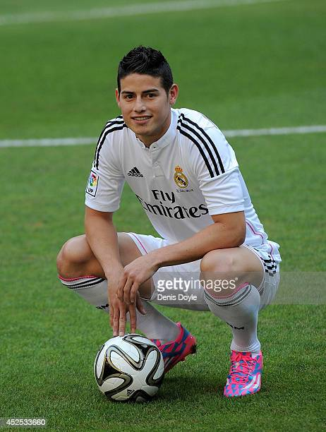 James Rodriguez poses for photographers during his unveiling as a new Real Madrid player at the Santaigo Bernabeu stadium on July 22 2014 in Madrid...