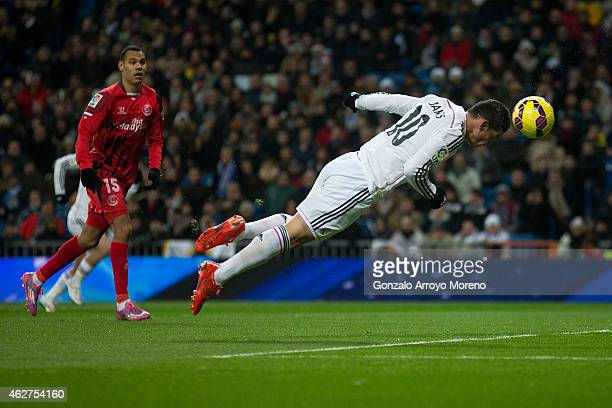 James Rodriguez scores their opening goal from a header during the La Liga match between Real Madrid CF and Sevilla FC at Estadio Santiago Bernabeu...