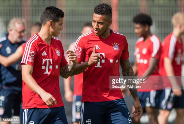 James Rodriguez talks to Corentin Tolisso during a training session at Saebener Strasse training ground on July 12 2017 in Munich Germany