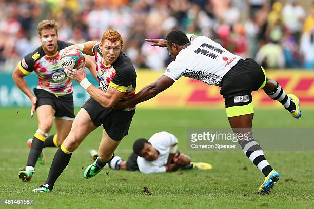 James Rodwell of England makes a break during the Cup semifinal match between England and Fiji during the 2014 Hong Kong Sevens at Hong Kong...