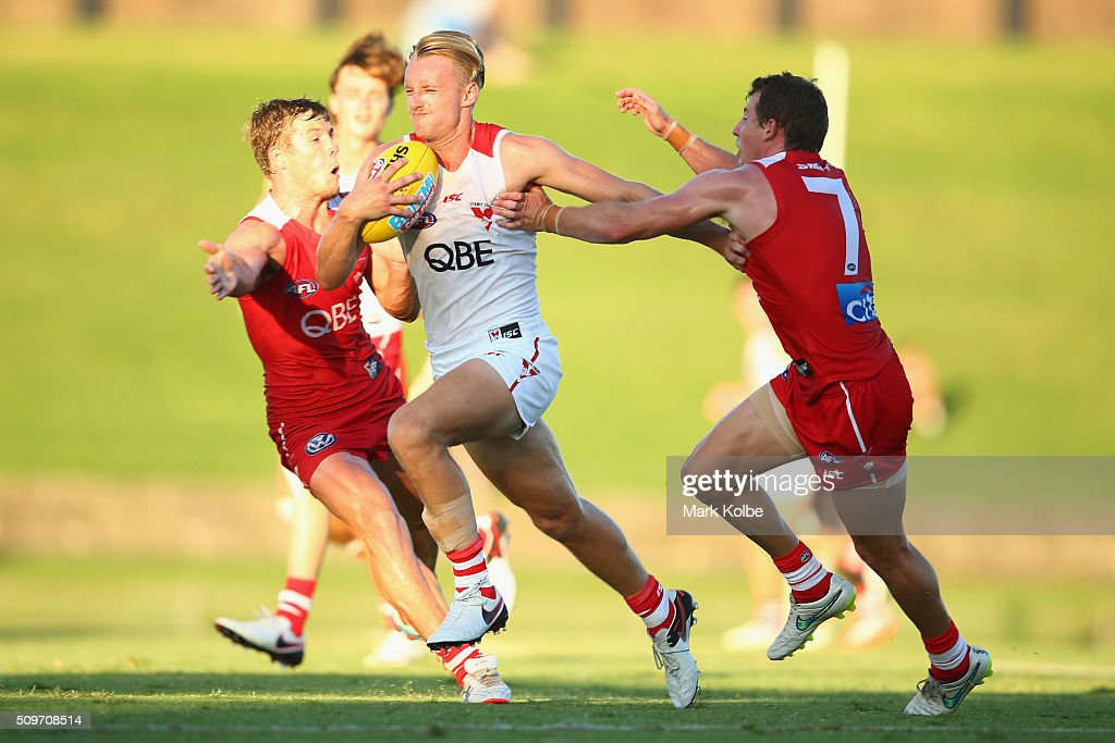 James Rose of the White team runs the ball during the Sydney Swans AFL intra-club match at Henson Park on February 12, 2016 in Sydney, Australia.
