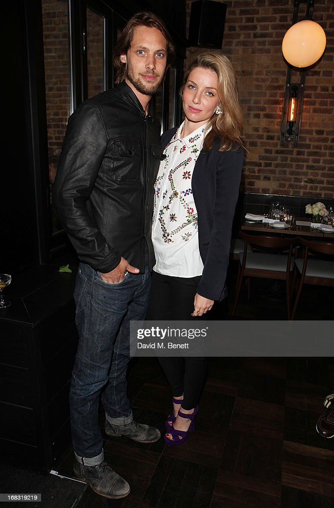 James Rousseau (L) and Annabelle Wallis attend the BLK DNM Dinner with Johan Lindeberg and Kim Sion at Beagle Restaurant on May 8, 2013 in London, England.