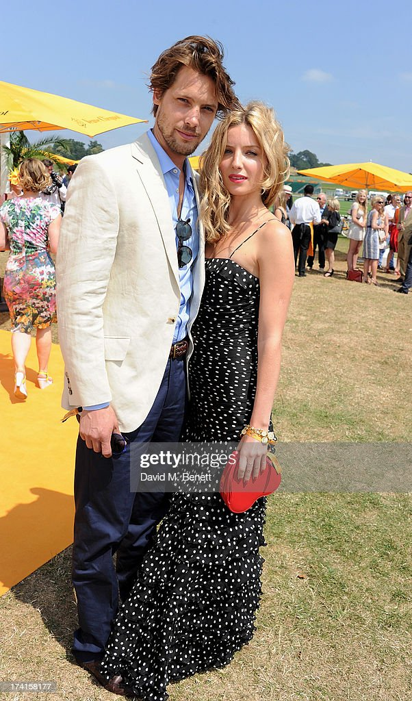 James Rousseau (L) and Annabelle Wallis attend the Veuve Clicquot Gold Cup Final at Cowdray Park Polo Club on July 21, 2013 in Midhurst, England.