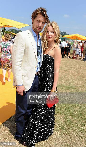 James Rousseau and Annabelle Wallis attend the Veuve Clicquot Gold Cup Final at Cowdray Park Polo Club on July 21 2013 in Midhurst England