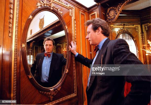 James Rylands of Sothebys examines the wood paneling from RMS Olympic sister ship of the Titanic which is to be removed from a Southport house and...
