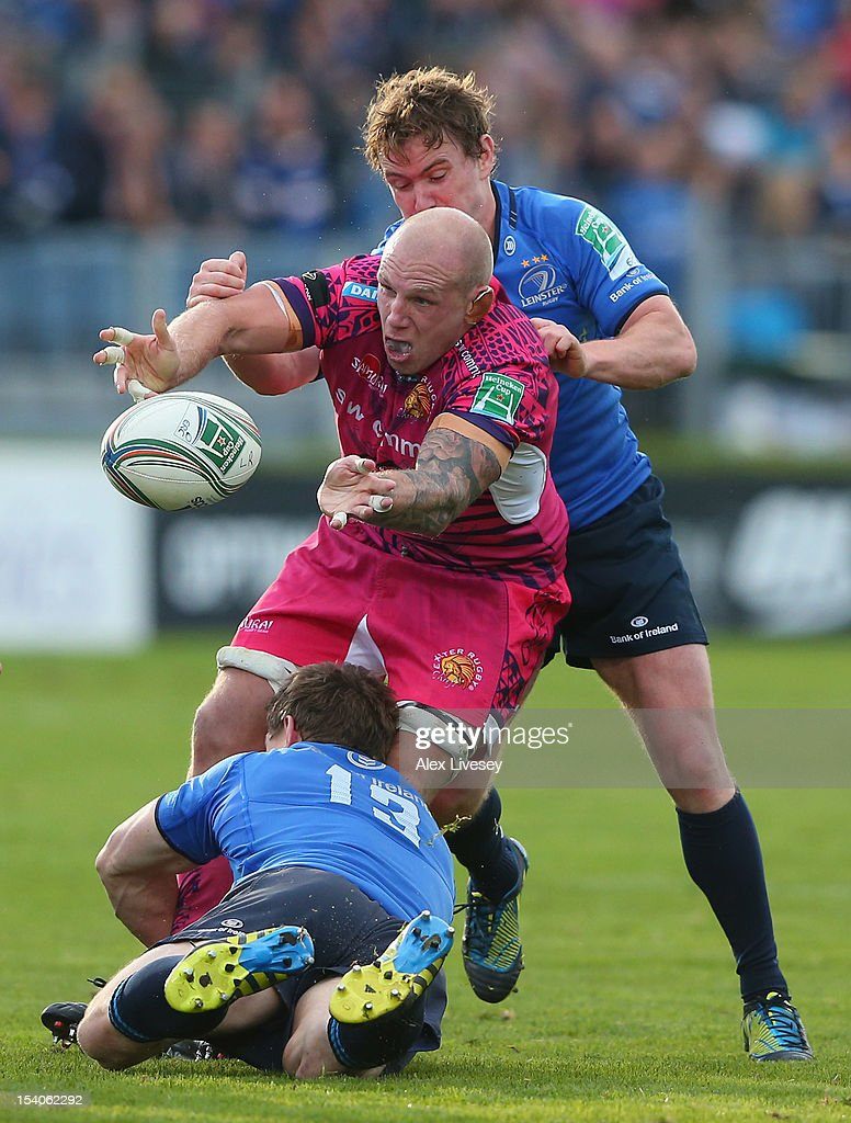 James Scaysbrook of Exeter Chiefs is tackled by <a gi-track='captionPersonalityLinkClicked' href=/galleries/search?phrase=Brian+O%27Driscoll&family=editorial&specificpeople=194745 ng-click='$event.stopPropagation()'>Brian O'Driscoll</a> of Leinster during the Heineken Cup Pool 5 match between Leinster and Exeter Chiefs at Royal Dublin Society on October 13, 2012 in Dublin, Ireland.