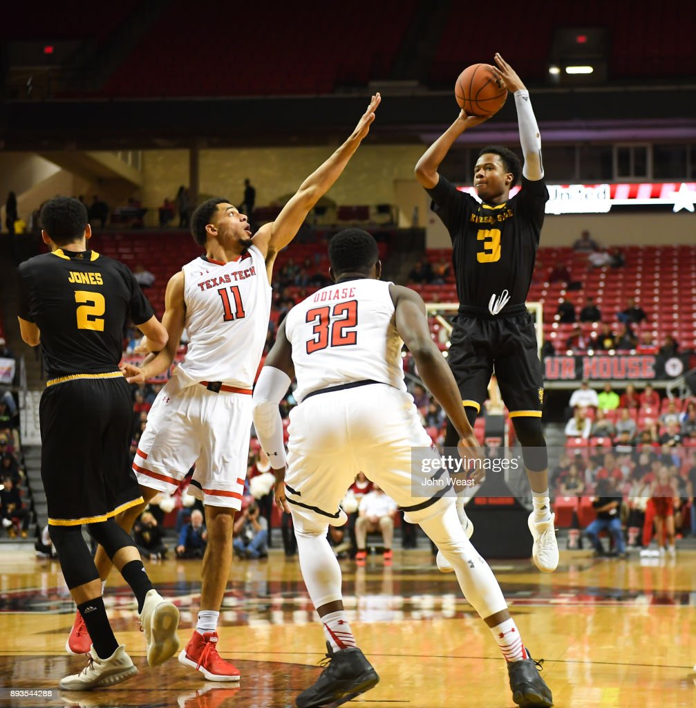 James Scott #3 of the Kennesaw State Owls shoots the ball over Zach Smith #11 of the Texas Tech Red Raiders during the game on December 13, 2017 at United Supermarkets Arena in Lubbock, Texas. Texas Tech defeated Kennesaw State 82-53.