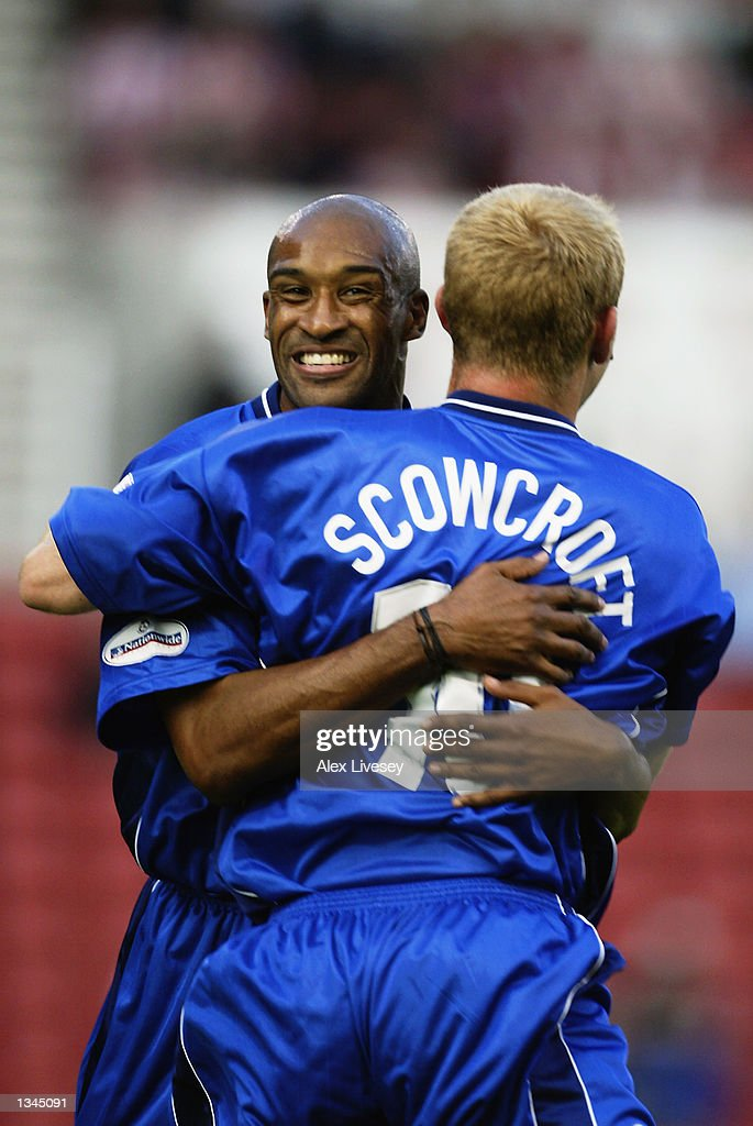 James Scowcroft of Leicester celebrates scoring with Brian Deane against Stoke during the Nationwide First Division match between Stoke City and Leicester City at the Brittania Stadium in Stoke on 14 August, 2002.