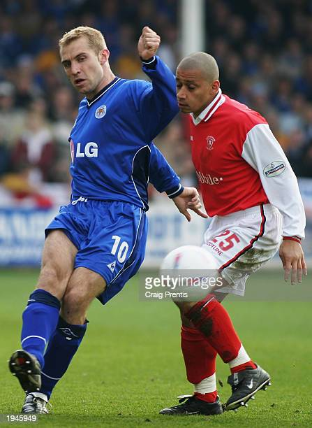 James Scowcroft of Leicester City holds off Curtis Woodhouse of Rotherham United during the Nationwide Division One match between Rotherham United...