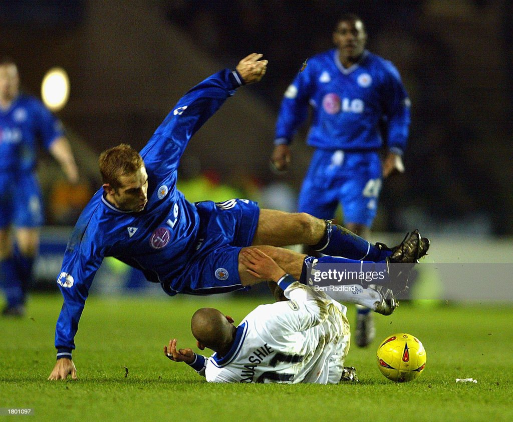 James Scowcroft of Leicester is pulled down by Nigel Quashie of Portsmouth during the Nationwide League Division One match between Leicester City and Portsmouth at Walkers Stadium, Leicester, England on February 17, 2003.