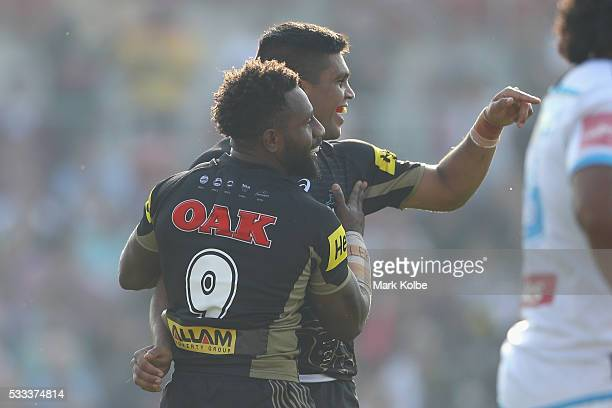 James Segeyaro and Tyrone Peachey of the Panthers celebrate a try scored by Peachey during the round 11 NRL match between the Penrith Panthers and...