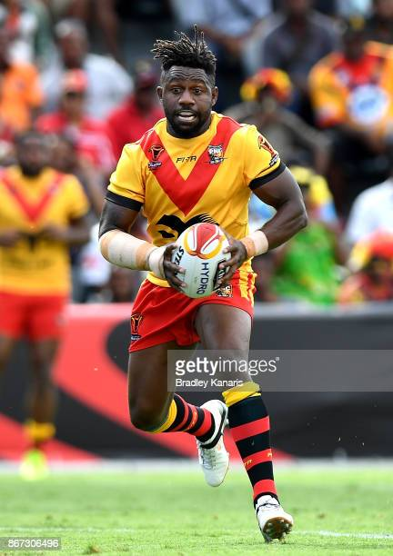 James Segeyaro of Papua New Guinea in action during the Rugby League World Cup match between Papua New Guinea and Wales at Oil Search National...