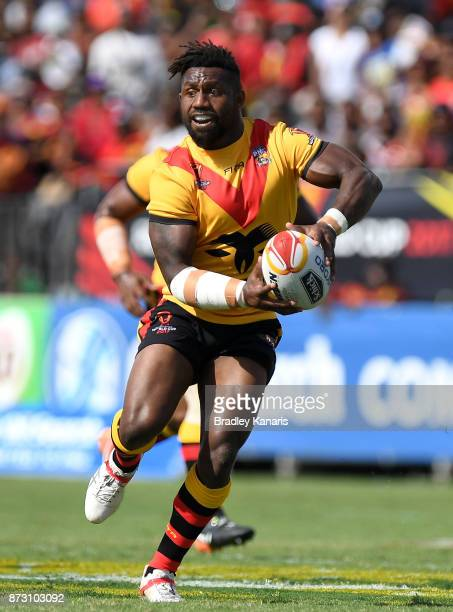James Segeyaro of Papua New Guinea looks to pass during the 2017 Rugby League World Cup match between Papua New Guinea and the United States on...