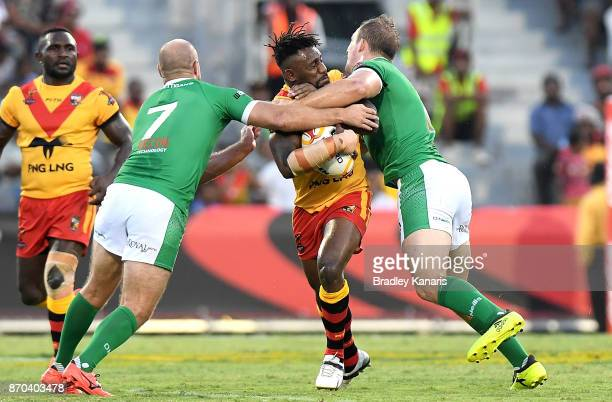 James Segeyaro of Papua New Guinea takes on the defence during the 2017 Rugby League World Cup match between Papua New Guinea Kumuls and Ireland on...