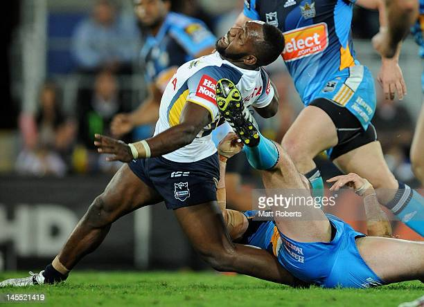 James Segeyaro of the Cowboys is tackled during the round 13 NRL match between the Gold Coast Titans and the North Queensland Cowboys at Skilled Park...