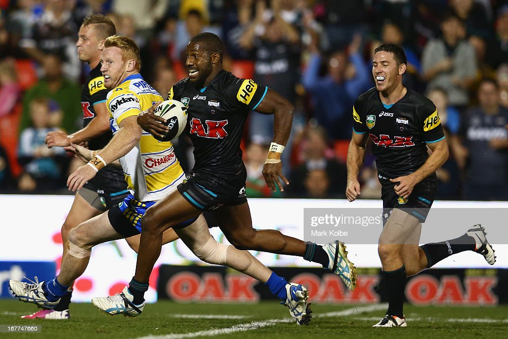 James Segeyaro of the Panthers breaks away to score a try during the round seven NRL match between the Penrith Panthers and the Parramatta Eels at Centrebet Stadium on April 29, 2013 in Penrith, Australia.