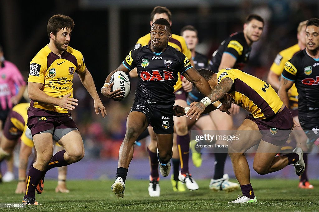 James Segeyaro of the Panthers breaks the Broncos defence during the round 24 NRL match between the Penrith Panthers and the Brisbane Broncos at Centrebet Stadium on August 23, 2013 in Sydney, Australia.