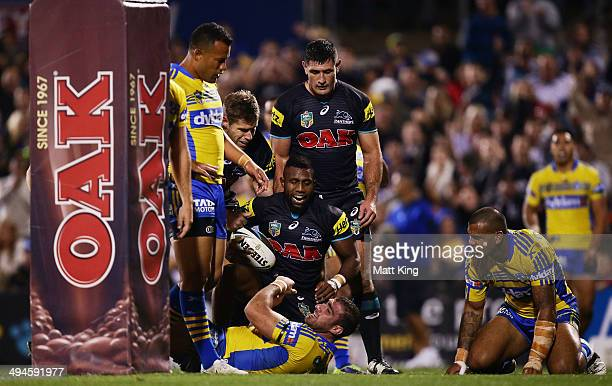 James Segeyaro of the Panthers celebrates scoring a try during the round 12 NRL match between the Penrith Panthers and the Parramatta Eels at...