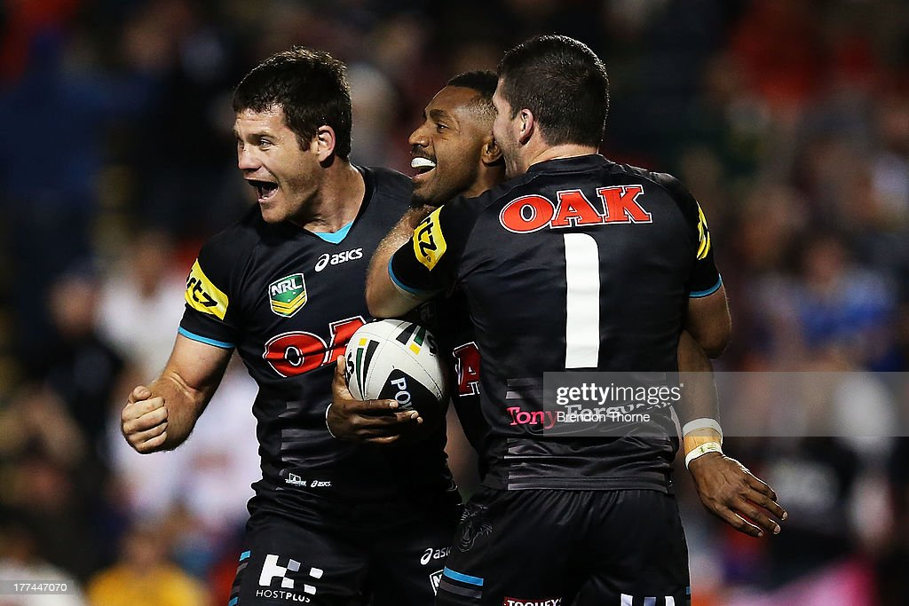 James Segeyaro of the Panthers celebrates with team mates after scoring his third try during the round 24 NRL match between the Penrith Panthers and the Brisbane Broncos at Centrebet Stadium on August 23, 2013 in Sydney, Australia.