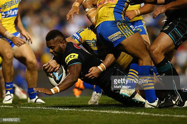 James Segeyaro of the Panthers dives over to score a try during the round 12 NRL match between the Penrith Panthers and the Parramatta Eels at...