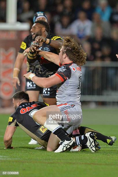 James Segeyaro of the Panthers hets punched in the face by Charlie Gubb of the Warriors during the round 10 NRL match between the Penrith Panthers...