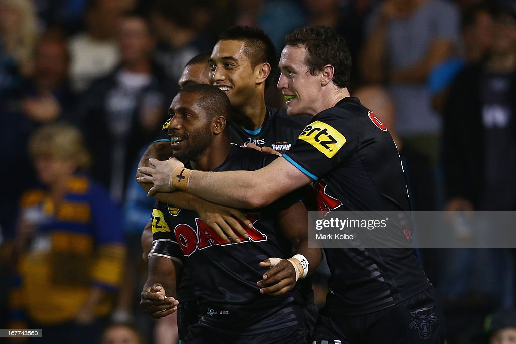James Segeyaro of the Panthers is congratulated by his team mates after scoring a try during the round seven NRL match between the Penrith Panthers and the Parramatta Eels at Centrebet Stadium on April 29, 2013 in Penrith, Australia.