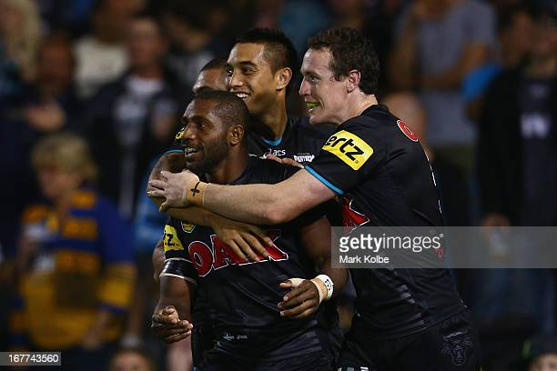 James Segeyaro of the Panthers is congratulated by his team mates after scoring a try during the round seven NRL match between the Penrith Panthers...