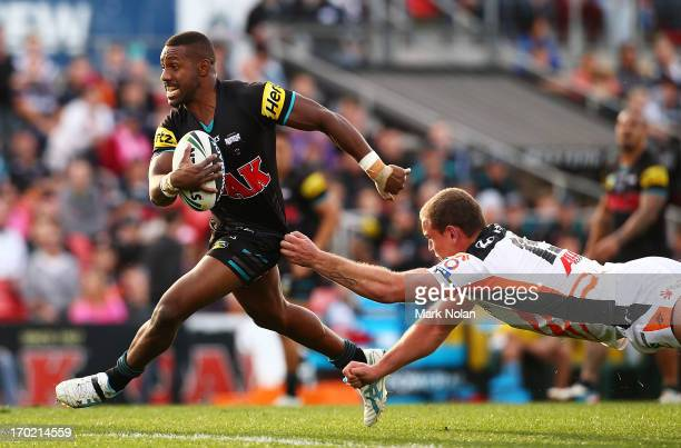 James Segeyaro of the Panthers makes a line break during the round 13 NRL match between the Penrith Panthers and the Wests Tigers at Centrebet...