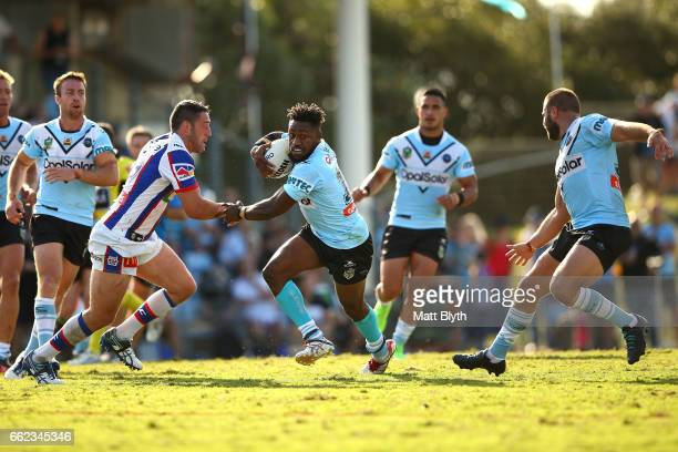 James Segeyaro of the Sharks is tackled during the round five NRL match between the Cronulla Sharks and the Newcastle Knights at Southern Cross Group...