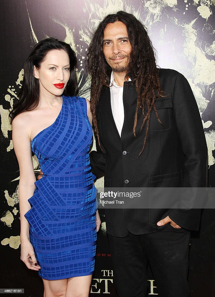 <a gi-track='captionPersonalityLinkClicked' href=/galleries/search?phrase=James+Shaffer&family=editorial&specificpeople=573015 ng-click='$event.stopPropagation()'>James Shaffer</a> aka Munky of the band KORN (R) and Evis Xheneti arrive at the Los Angeles Premiere of 'The Quiet Ones' held at The Theatre at Ace Hotel on April 22, 2014 in Los Angeles, California.