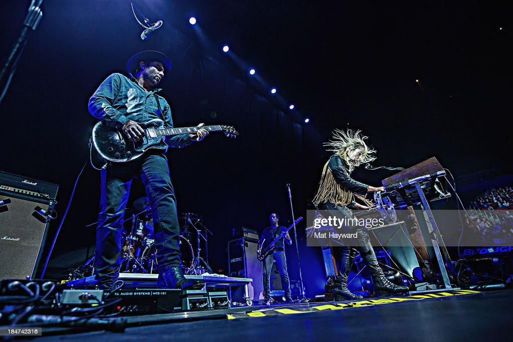James Shaw (L) and <a gi-track='captionPersonalityLinkClicked' href=/galleries/search?phrase=Emily+Haines&family=editorial&specificpeople=557275 ng-click='$event.stopPropagation()'>Emily Haines</a> of Metric perform on stage at Key Arena on October 15, 2013 in Seattle, Washington.