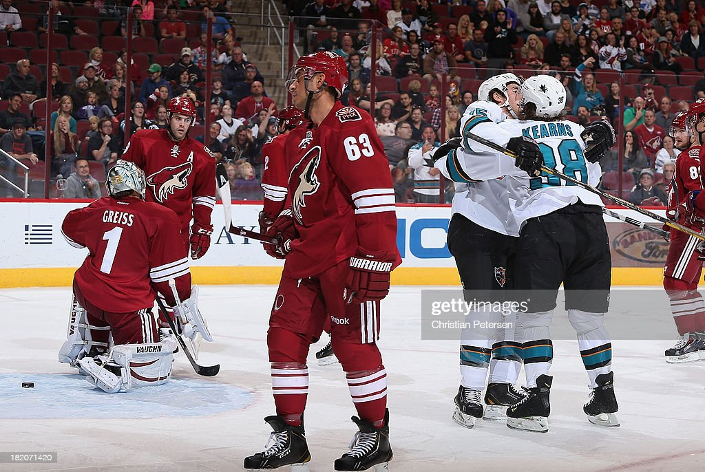 James Sheppard #15 and Bracken Kearns #38 of the San Jose Sharks celebrate after Kearns scored a third period goal past goaltender Thomas Greiss #1 of the Phoenix Coyotes the Phoenix Coyotes during the preseason NHL game at Jobing.com Arena on September 27, 2013 in Glendale, Arizona.