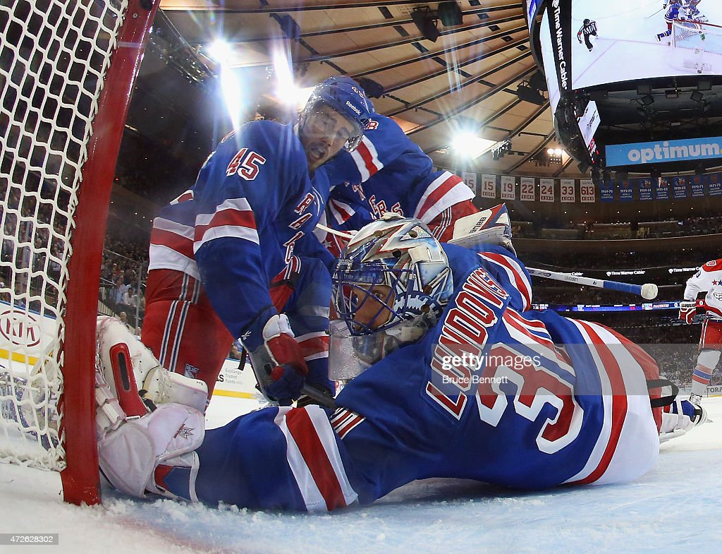 James Sheppard and Henrik Lundqvist of the New York Rangers defend the net against the Washington Capitals in Game Five of the Eastern Conference...
