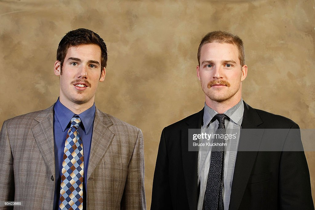 James Sheppard and Kyle Brodziak of the Minnesota Wild show off their November moustaches prior to the game against the Boston Bruins at the Xcel...