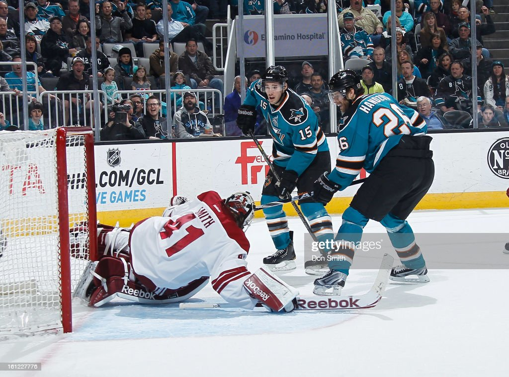 James Sheppard #15 and Michal Handzus #26 of the San Jose Sharks attack the net against Mike Smith #41 of the Phoenix Coyotes during an NHL game on February 9, 2013 at HP Pavilion in San Jose, California.