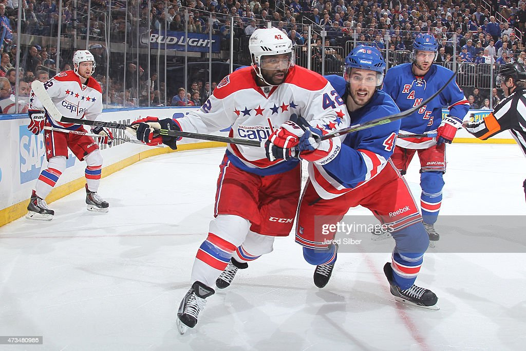 James Sheppard of the New York Rangers skates against Joel Ward of the Washington Capitals in Game Seven of the Eastern Conference Semifinals during...