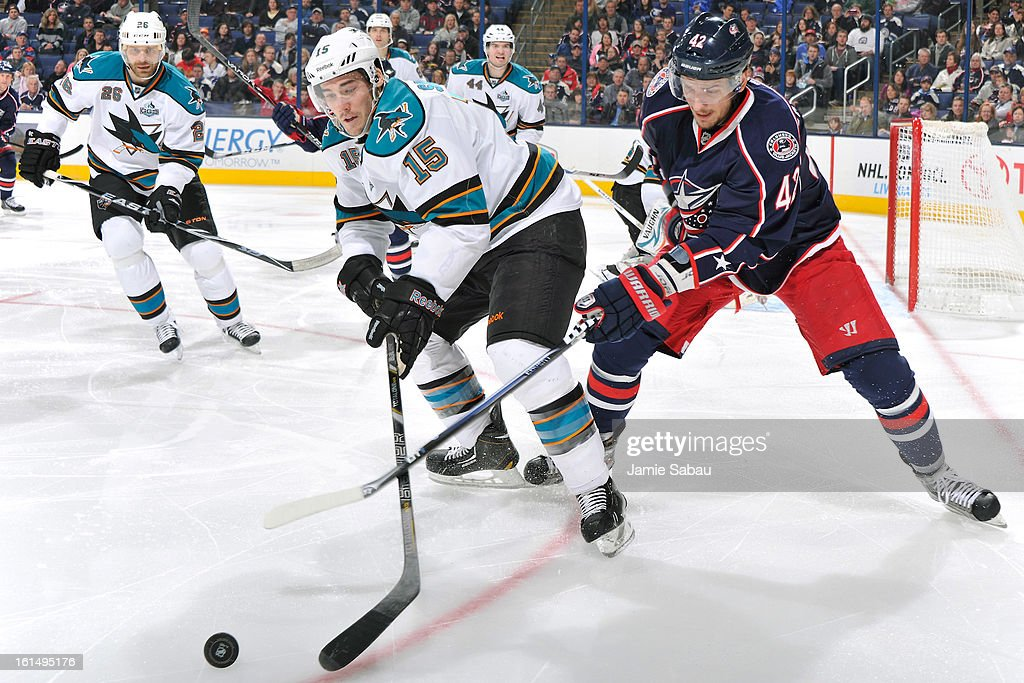 <a gi-track='captionPersonalityLinkClicked' href=/galleries/search?phrase=James+Sheppard&family=editorial&specificpeople=537966 ng-click='$event.stopPropagation()'>James Sheppard</a> #15 of the San Jose Sharks and <a gi-track='captionPersonalityLinkClicked' href=/galleries/search?phrase=Artem+Anisimov&family=editorial&specificpeople=543215 ng-click='$event.stopPropagation()'>Artem Anisimov</a> #42 of the Columbus Blue Jackets battle for control of a loose puck during the third period on February 11, 2013 at Nationwide Arena in Columbus, Ohio. Columbus defeated San Jose 6-2.
