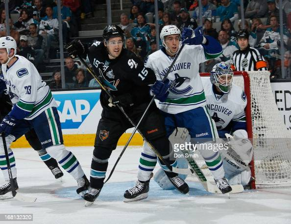 James Sheppard of the San Jose Sharks creates traffic in front of the net against Frank Corrado and Cory Schneider of the Vancouver Canucks in Game...