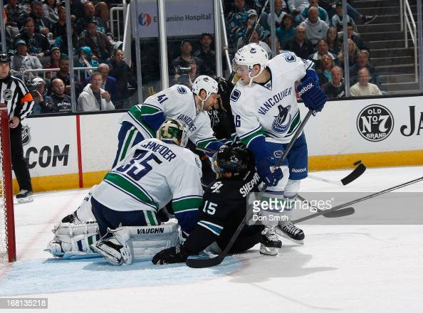 James Sheppard of the San Jose Sharks creates traffic in front of the net against Cory Schneider Frank Corrado and Andrew Alberts of the Vancouver...