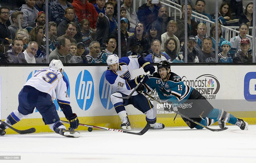 James Sheppard of the San Jose Sharks goes for the puck against Scott Nichol and Adam Cracknell of the St Louis Blues at HP Pavilion on March 9 2013...