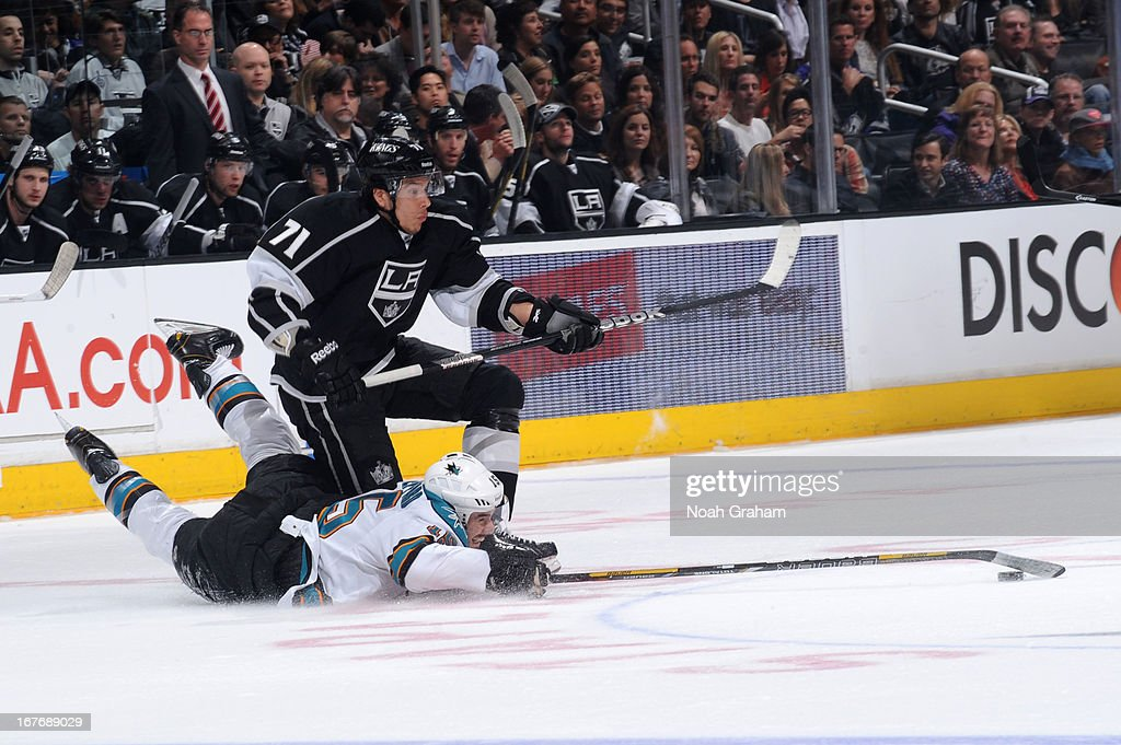 <a gi-track='captionPersonalityLinkClicked' href=/galleries/search?phrase=James+Sheppard&family=editorial&specificpeople=537966 ng-click='$event.stopPropagation()'>James Sheppard</a> #15 of the San Jose Sharks reaches for the puck against <a gi-track='captionPersonalityLinkClicked' href=/galleries/search?phrase=Jordan+Nolan&family=editorial&specificpeople=4161890 ng-click='$event.stopPropagation()'>Jordan Nolan</a> #71 of the Los Angeles Kings at Staples Center on April 27, 2013 in Los Angeles, California.
