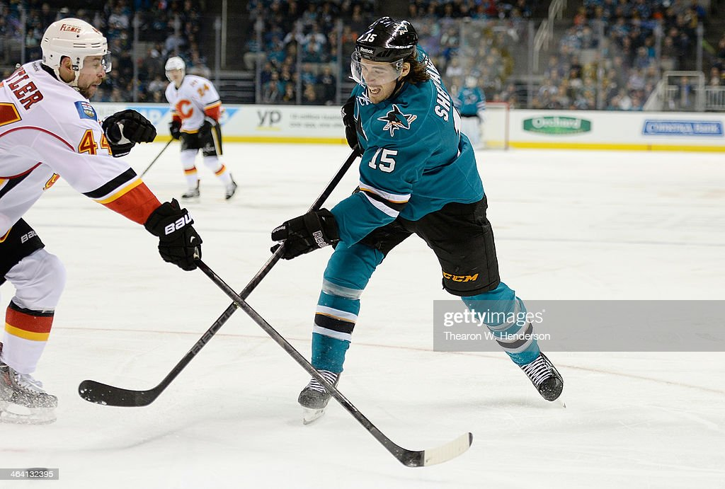 <a gi-track='captionPersonalityLinkClicked' href=/galleries/search?phrase=James+Sheppard&family=editorial&specificpeople=537966 ng-click='$event.stopPropagation()'>James Sheppard</a> #15 of the San Jose Sharks shoots on goal, getting his shot past Chris Butler #44 of the Calgary Flames during the second period at SAP Center on January 20, 2014 in San Jose, California. The Sharks won the game 3-2.