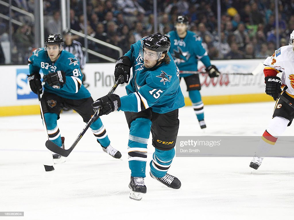 <a gi-track='captionPersonalityLinkClicked' href=/galleries/search?phrase=James+Sheppard&family=editorial&specificpeople=537966 ng-click='$event.stopPropagation()'>James Sheppard</a> #15 of the San Jose Sharks takes a shot against the Calgary Flames during an NHL game on October 19, 2013 at SAP Center in San Jose, California.