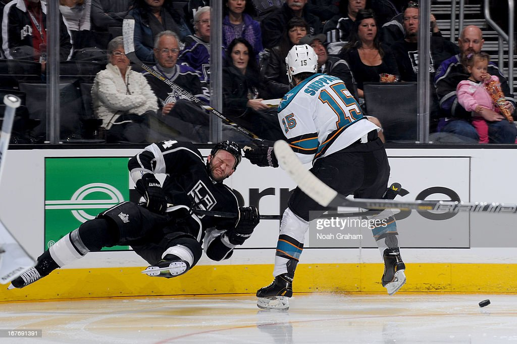 <a gi-track='captionPersonalityLinkClicked' href=/galleries/search?phrase=James+Sheppard&family=editorial&specificpeople=537966 ng-click='$event.stopPropagation()'>James Sheppard</a> #15 of the San Jose Sharks throws the check against <a gi-track='captionPersonalityLinkClicked' href=/galleries/search?phrase=Robyn+Regehr&family=editorial&specificpeople=171828 ng-click='$event.stopPropagation()'>Robyn Regehr</a> #44 of the Los Angeles Kings at Staples Center on April 27, 2013 in Los Angeles, California.
