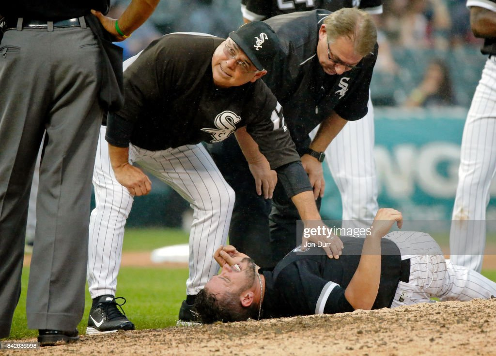 James Shields #33 of the Chicago White Sox is checked on by manager Rick Renteria #17 (L) and head trainer Herman Schneider (R) after being hit in the right leg by a line drive hit by Francisco Mejia #33 of the Cleveland Indians (not pictured) during the seventh inning at Guaranteed Rate Field on September 4, 2017 in Chicago, Illinois.