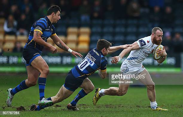 James Short of Exeter Chiefs breaks through the tackle of Tom Heathcote of Worcester Warriors during the Aviva Premiership match between Worcester...
