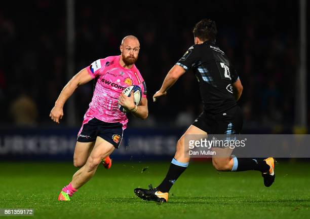 James Short of Exeter Chiefs takes on Sam Johnson of Glasgow Warriors during the European Rugby Champions Cup Pool 3 match between Exeter Chiefs and...
