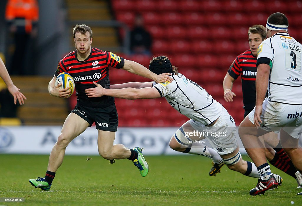 James Short of Saracens is tackled during the Aviva Premiership match between Saracens and Sale Sharks at Vicarage Road on January 6, 2013 in Watford, England.