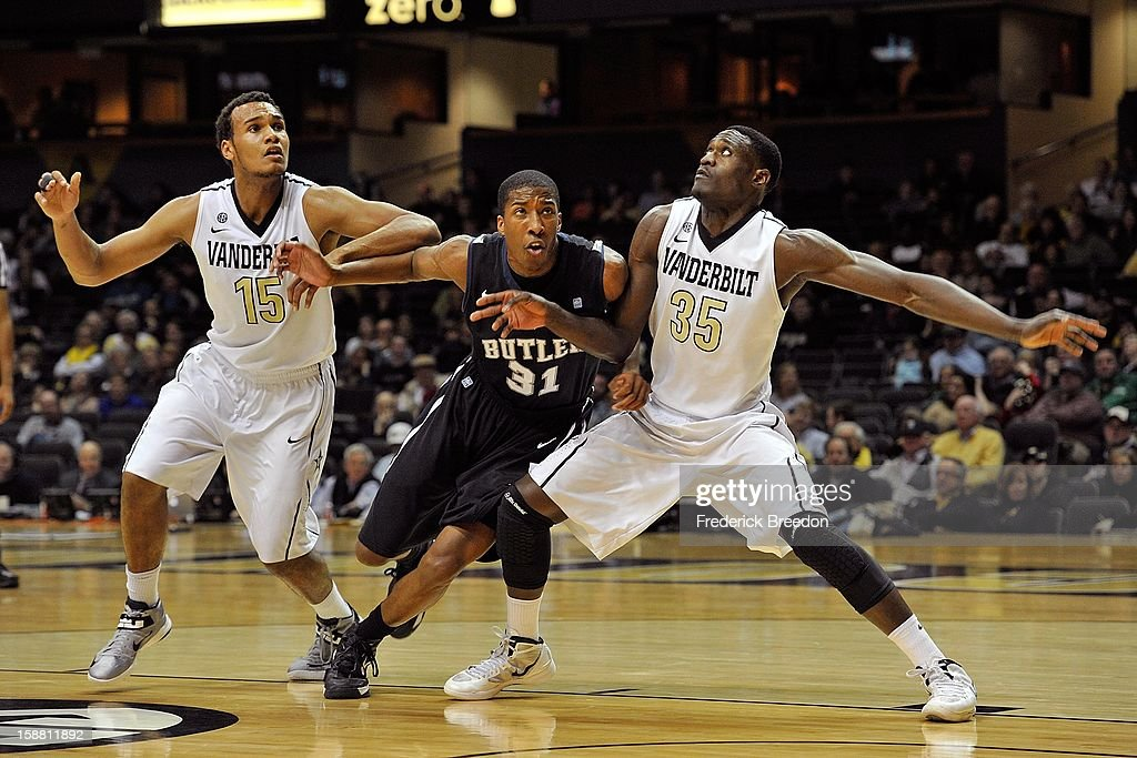 James Siakam #35 and Kevin Bright #15 of the Vanderbilt Commodores play against Kameron Woods #31 of the Butler Bulldogs at Memorial Gym on December 29, 2012 in Nashville, Tennessee.